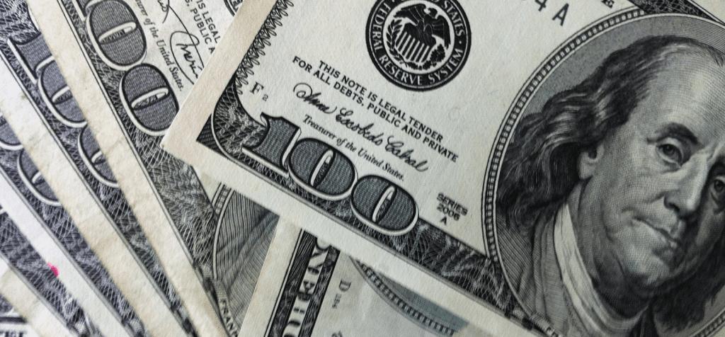 A close up of a pile of $100 U.S. bills