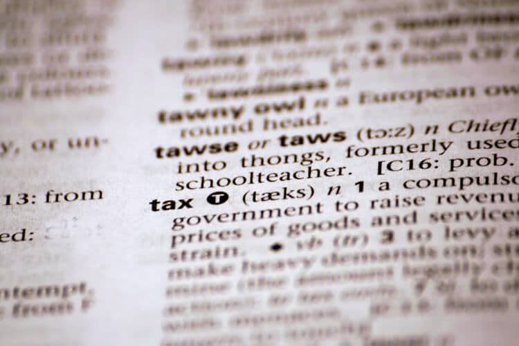 "A photo of the word ""tax"" in a dictionary"