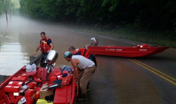 Coast Guard Marine Safety Unit Huntington Western River Flood Punt Team making preparations to get underway near Clendenin, West Virginia, June 24, 2016. The team is assisting in the flood response by responding to 911 calls, transporting locals to safety, delivering water and clearing roadways of fallen trees. U.S. Coast Guard photo