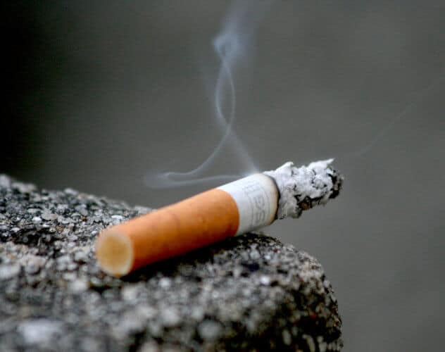 A burning cigarette photographed up close