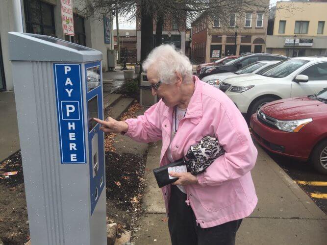Marjorie Jablonski demonstrates the trouble she was having with a Bridgeville parking kiosk
