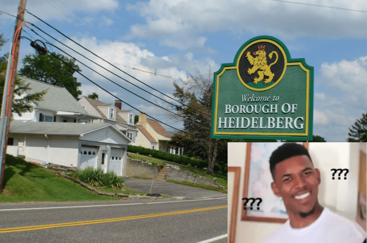 a heidelberg street sign and a confused man