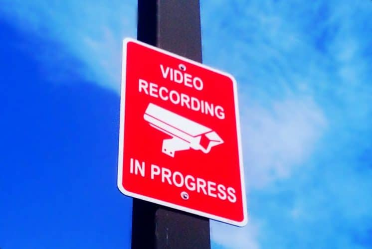 "A parking lot sign that reads: ""Video Recording in Progress"""