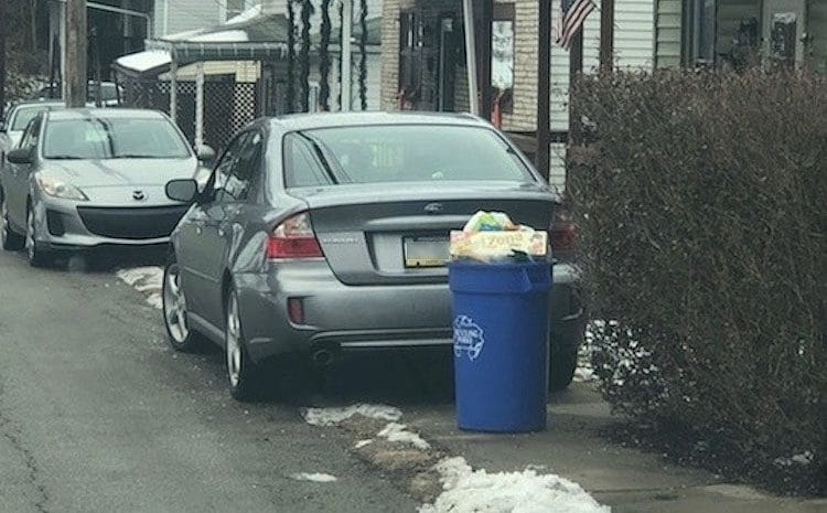 A car parked on the sidewalk on Mill Street in Bridgeville