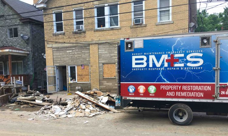 A property restoration truck parked outside a building on Baldwin Street days after the June 2018 flood.